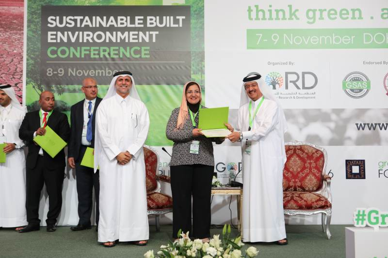 Eman Farag receiving sustainability award