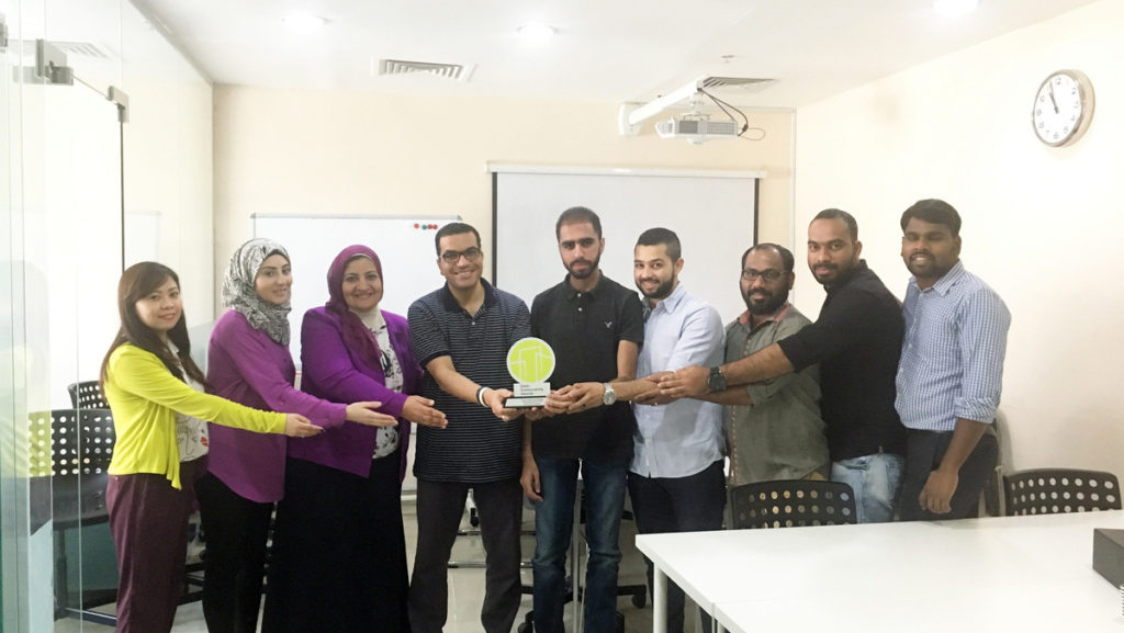 qgl team celebrating awards